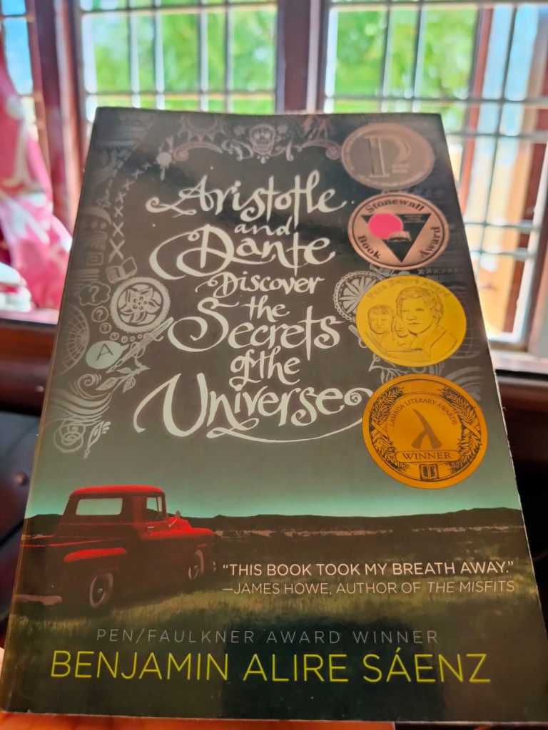 Original Book Cover of Aristotle and Dante Discover the Secrets of the Universe Click by thescribblersrefuge.com Image Copyright @thescribblersrefuge.com 2021 Book Review